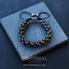 Explore the intricate details of our special Gunmetal Black & Black Swarovski 'Swarm' Bracelet | Designed with our unique handcrafted skulls & created with meticulous attention to detail, this piece features a precision cut clear Swarovski crystal set in each eye of every skull; it's a stand out statement piece that will adorn the wrist beautifully | Available now at Northskull.com [Worldwide Shipping] #Luxury #Jewelry #MensFashion