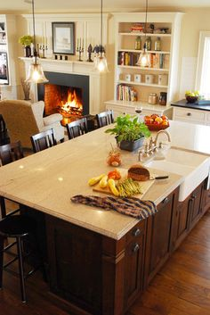Floor vs. island colors, countertop on island is light, countertops on perimeter are dark. Farmhouse Kitchen Renovation - traditional - kitchen - The Bellepoint Company