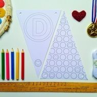 Make your own Father's Day Bunting Kit from The Bunting Club. The bunting flags read 'Love You Daddy' and make a really personal decoration.