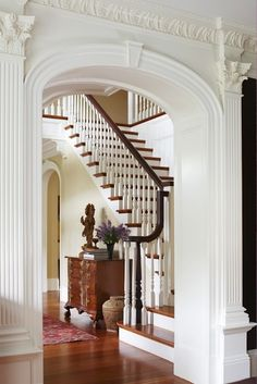 Lay your ever-lovin' eyes on that crown molding. And the entire archway, really. The columns give the passage such weight but that lovely molding softens it with a topping of spun sugar.