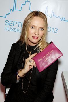 UmaThurman-carries-Comes-WIth-Baggage—-What-are-you-Bitches-lookin-at_-Clutch