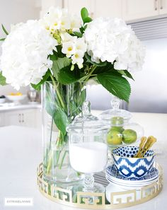 Beautiful hydrangeas and freesias paired with blue and white ikat bowls and dishes create a beautiful kitchen table centerpiece.
