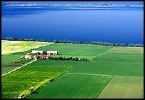 Fields bordering lake Vattern near Granna. Gotaland, Sweden ( color)