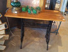 Unique sofa table. Vintage sewing machine base with wood top! #restylechicago #reluxvintage #resaleshop #resale https://www.instagram.com/p/BQ_f0AvgxJT/
