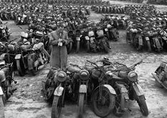 Surplus military motorcycles in England are bundled in groups of five to be sold as scrap, by William Vanderson (1946)