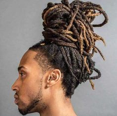 The top knot hairstyle is a perfect choice for men with long hair, preferably those that stretch to the shoulders and beyond. Dreadlock Hairstyles For Men, Man Bun Hairstyles, Dreadlocks Men, Locs, Dread Bun, Dreads Styles, Top Knot, Long Hair Styles, Hair Ideas