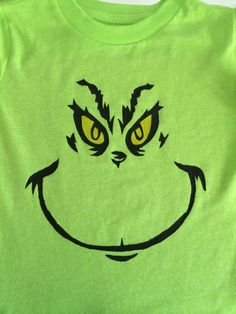 Gavin wanted a Grinch shirt for Dr. Seuss week. Made a stencil with Reynolds freezer paper and painted the face on!