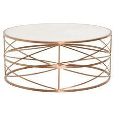 Update your coffee table with the attention-grabbing look of this Gray Manor round coffee table. The attractive rose gold color and distinct oval shape adds transitional style to your living room or s