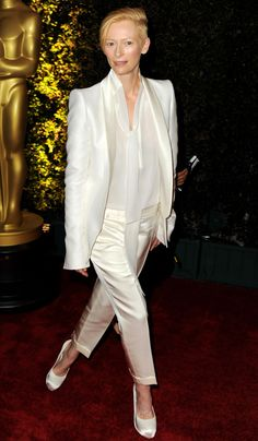 Tailored satin and silk tux. Tilda Swinton always knows how to bring it.