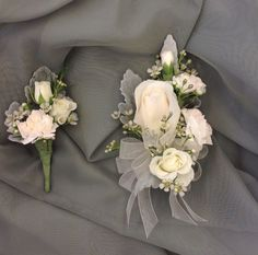 Soft pink and white mother and father of the bride corsage and boutonniere by Nancy at Belton hyvee.