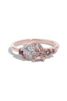 This custom Cluster This custom Cluster Ring features an heirloom .38ct diamond set with 5x3mm oval morganite, 5x2.5mm marquise morganite and four 2mm - 2.5mm spinels set in a low prong style setting in polished 14kt rose gold.