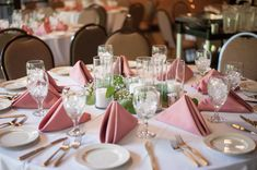 Simple and elegant centerpiece for a wedding reception.  Bellagala Photography