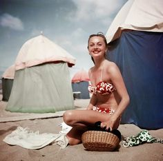 Woman in a bikini at the beach in Deauville, France, August 1951: photo Robert Capa