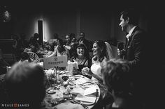 A black and white image of the groom delivery his wedding speech at the RSA, London.