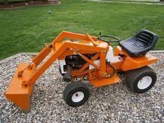 Orange Garden Tractor With Front Loader : Easy To Use Garden Tractors Used Garden Tractors, Small Garden Tractor, Garden Tractor Pulling, Yard Tractors, Small City Garden, Small Tractors, Compact Tractors, Rack Bike, Garden Tractor Attachments
