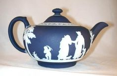 "Description: A beautiful dark blue colored jasperware Wedgwood teapot with a spout and applied handle. The teapot, which displays Wedgwood markings from the period 1891-1908, is ~4 3/4"" high to the to"