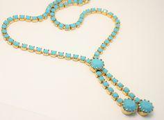 Vintage ncklace. Turquoise rhinestone necklace. Tassel necklace by chicvintageboutique on Etsy https://www.etsy.com/listing/240202190/vintage-ncklace-turquoise-rhinestone