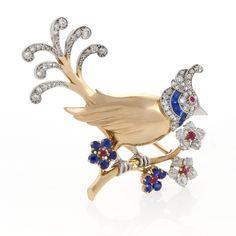 A Mauboussin Paris Gold, Diamond, Ruby and Sapphire Bird Brooch