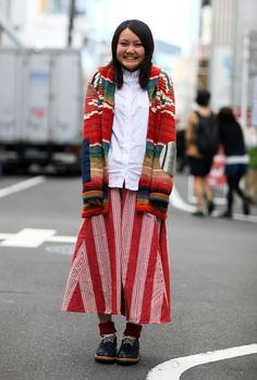 Streetpeeper.com Street Fashion Jacket: Knit Jacket over White Shirt Skirt: Red and White Diagonal Striped Skirt Shoes: Black Shoes with Red Ankle Warmers Photo By: Phil Oh
