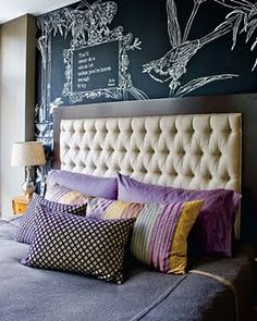 not usually a fan of purple but THIS i like! and i'm always prone to swoon over an upholstered headboard w/ buttons...