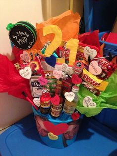 """My version of the """"man bouquet"""" I found on Pinterest. Can't take credit for this brilliant idea! Lots of goodies my boyfriend likes, as well as some add-ins I made. Perfect for a birthday :)"""