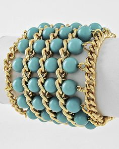 "Look  at this beautiful Bracelet!    Aqua Blue Beads surrond this gold tone chain cuff bracelet    Dress up or go Casual, either way you will reach for this bracelet again and again!    Lobster claw closure    •   Length : 8 1/4"" + EXT  •   Width : 2 1/2"""