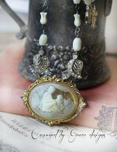 """Mother and Child ~ vintage assemblage necklace """"mother and child"""" handmade one of a kind mother of pearl tulips crownedbygrace Antique Bracelets, Upcycled Vintage, Repurposed, Button Bracelet, Mother And Child, Pearl Beads, Antique Gold, Vintage Jewelry, Jewelry Making"""