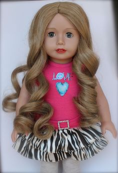 18 inch Doll, Cadence Rose has beautiful blonde locks of hair and blue eyes. She is soft bodied, has poseable limbs, premium wigged hair, and open & close eyes. Harmony Club Dolls are same size as American Girl 18 inch Dolls...available at www.harmonyclubdolls.com