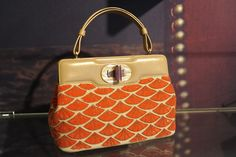 Spring 2013 Accessories Roundup: Milan: BULGARI- A Chinese fan motif was a strong element at Bulgari, such as the one here on the sequined Isabella Rossellini, a staple style for the house.
