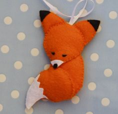 Sleepy felt fox ornament