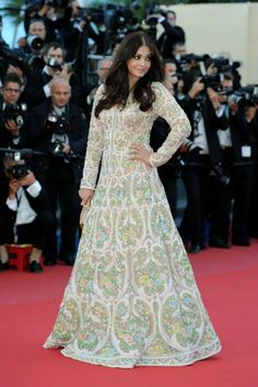 Aishwarya Rai Bachchan hits the Red Carpet in a heavily embellished floral Abu Jani Sandeep Khosla dress covered in pearls at Cannes 2013 for the screening of 'Blood Ties' source: https://www.facebook.com/AbuJaniSandeepKhosla