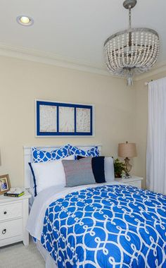 A chandelier made of stones and shells dresses up this guest suite with charming coastal style.