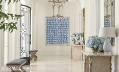 This modern art is the perfect complement to the more formal feel of this entrance.