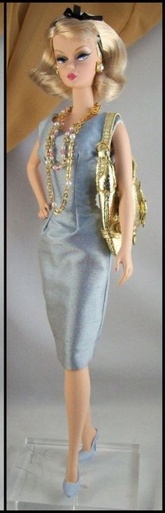 BArbie Silkstone in blue and gold bag