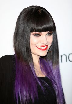 Jessie J rocks the dip-dye hair colour trend like no other, with vibrant purple ends contrasting with sleek black lengths and a full and sharp fringe. Go Jessie!