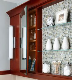 Maximize Wall Space  A wall-hung shelving unit adds storage without taking up precious floor space, and the addition of mosaic tile behind the open shelves adds color and texture.