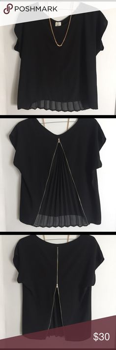 Black Top w/ Shear opening Perfect for weekends! Loose fitting to pair with a tight skirt. Operable zipper to expose your back(flexible to any bra available). Super unique! No damage, great quality, worn a few times Francesca's Collections Tops