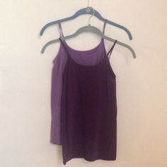 The limited purple tank bundle Two purple tagless, seamless tanks. Can be worn layered or under another blouse. Stretchy and soft. Gently used- great condition. The Limited Tops Tank Tops