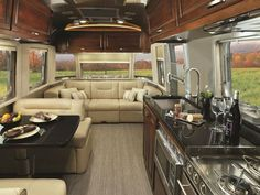Stainless steel appliances line the kitchen area. Airstream Trailer - 2015 Airstream Campers - Country Living