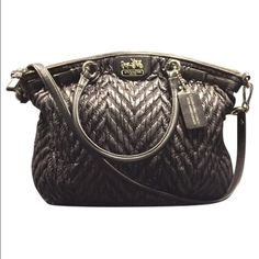 """Coach 70th Anniversary Purse Luxurious and lightweight, beautifully textured and intricately quilted extra-spacious shoulder silhouette with hand-worked leather trim and custom hardware. Gathered nylon with leather trim Inside zip, cell phone and multifunction pockets Zip-top closure, fabric lining Straps with 6"""" drop Longer strap for shoulder wear 15 3/4"""" (L) x 14 1/4"""" (H) x 4"""" (W). This bag is absolutely amazing. One of my favorites. It's in great condition. Inside is in used condition…"""
