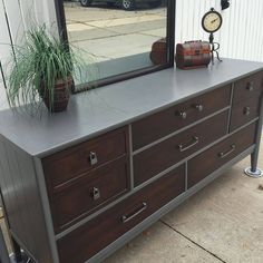 Laura Hernandez refinished this sleek Drexel dresser using General Finishes Java Gel Stain and High Performance Top Coat in Satin. Waverly's Elephant gray paint was used for the top and sides. You could re-create this look using General Finishes Driftwood Milk Paint!