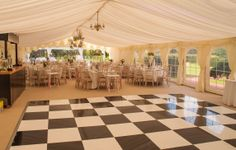 Chequered dance floor, wedding marquee & fixtures by www.24carrotevents.co.uk