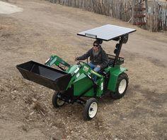 Solar Powered Tractor ( Go solar young man, go solar!) I wonder if John Deere makes them.