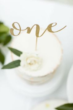 """One"" cake topper from a Floral First Birthday Party on Kara's Party Ideas 