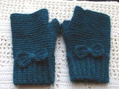 Cute fingerless gloves in Alpaca  - start with ribbing by crocheting in back loops only, then use this basic pattern: http://www.ravelry.com/patterns/library/basic-fingerless-mittens and finally add sweet crochet bows