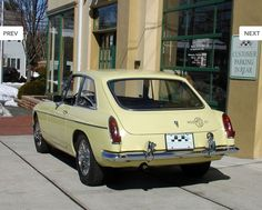 """1967 MG BGT in pale yellow with black interior and white piping.. This very clean and unmolested MGB GT was a California """"black plate"""" car brought to New Jersey in 2004. Since then, it has traveled less than 3,000 miles. Many consider the '67 the most desirable year with traditional dashboard and chrome bumpers. Please call to schedule a test drive: 609-466-5305. VIN#: GHD3L121477 Odometer: 30,262 miles"""