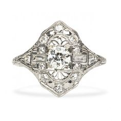 Love the craftsmanship of this piece. But perhaps a little over the top for me. I don't like how it tapers to the sides.  Art Deco Engagement Ring