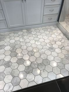 Love this grey with the darker grout. Hexagon floor tile in bathroom #hexagon