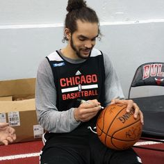Following Monday's practice, Joakim Noah and his teammates signed items that will benefit Chicago Bulls Charities.