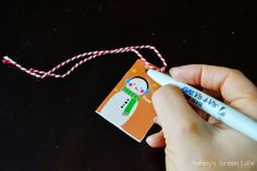 Eco-Friendly Christmas Wrap Idea: Laminate gift tags and write on them with wet-erase markers so they will last for years to come!
